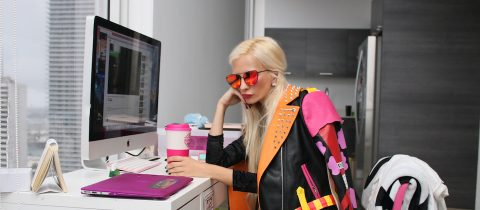 A fashion blogger sitting at a desk