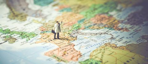 Figurine of man on france part of world map