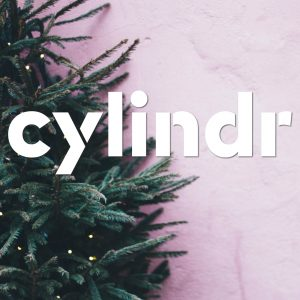 cylindr logo on top of Christmas tree on pink background