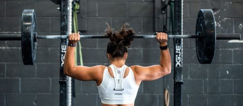 Powerful woman lifting heavy weight